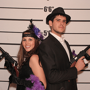 Denver Murder Mystery party guests pose for mugshots